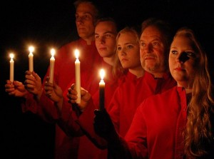 Five singers holding candles
