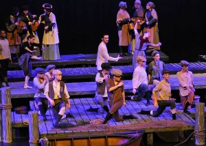 The cast members of Peter Grimes dance in the opening scene