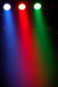 A photo of blue, red, and green stage spotlights