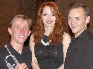 A photo of trumpet player Eric Meincke with Praeclara vocalists Kelly Singer and Jonathan Pillow