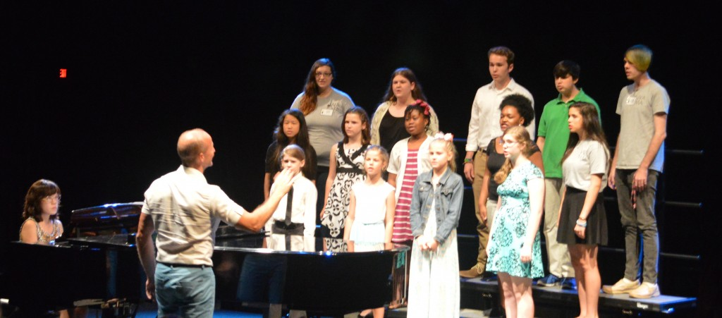 Bevan Keating conducts a choir of teenaged vocalists at WAMA, accompanied by collaborative artist Kyung-Eun Na