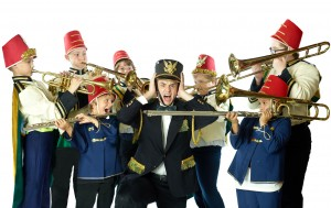 Professor Harold Hill surrounded by young boys in band uniforms