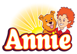 The characters of Annie and Sandy the dog appear in front of a sunrise