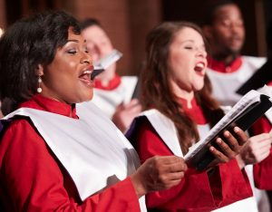Members of the Praeclara Vocal Company singing a choral masterwork